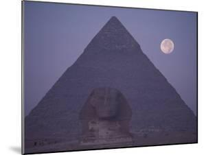 A View of the Great Sphinx with a Full Moon and the Great Pyramid in the Background by Bill Ellzey