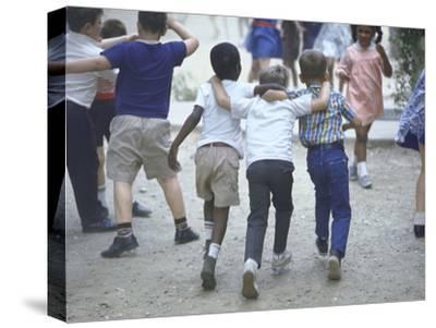 At the Desegregated Lusher School Three Boys Display Camaraderie Walking Through Playground