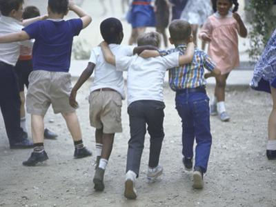At the Desegregated Lusher School Three Boys Display Camaraderie Walking Through Playground by Bill Eppridge