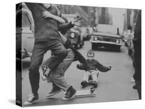 Boys Skateboarding in the Streets by Bill Eppridge