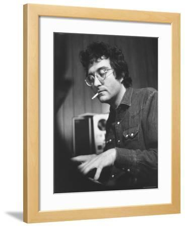 Composer Randy Newman Working at Piano, Smoking Cigarette