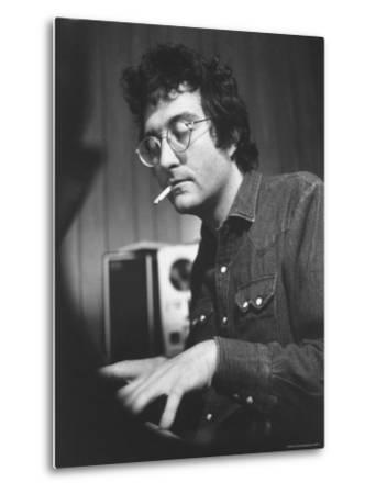 Composer Randy Newman Working at Piano, Smoking Cigarette by Bill Eppridge