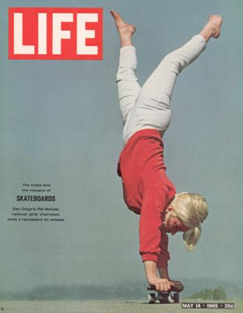 Girl Doing Handstand on Skateboard, May 14, 1965 by Bill Eppridge