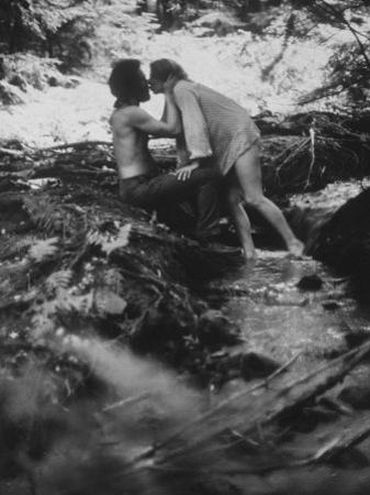 Hippie Couple Kissing at Woodstock Music Festival by Bill Eppridge