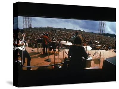 Huge Crowd Listening to a Band Onstage at the Woodstock Music and Art Festival