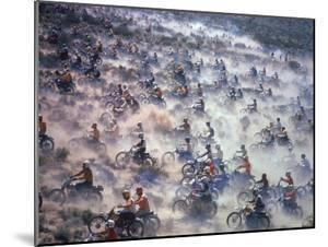 Motorcyclists Racing 75 Miles Cross Country Through Mojave Desert by Bill Eppridge