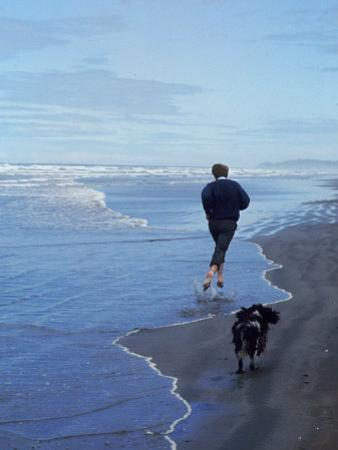 Presidential Candidate Bobby Kennedy and His Dog, Freckles, Running on an Oregon Beach by Bill Eppridge