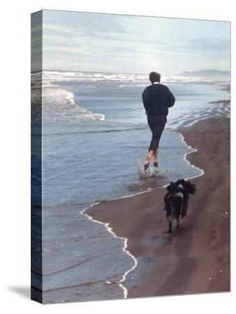 Presidential Candidate Bobby Kennedy and His Dog, Freckles, Running on Beach