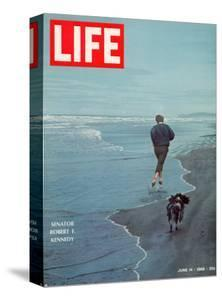 Robert F. Kennedy Jogging on the Beach with his Dog, June 14, 1968 by Bill Eppridge