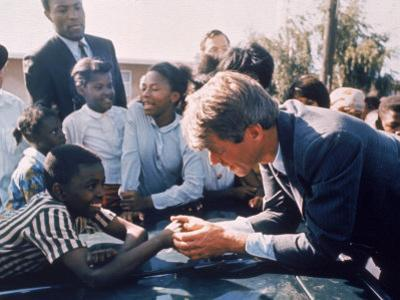 Robert F. Kennedy Meeting with Some African American Kids During Political Campaign by Bill Eppridge