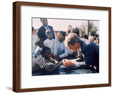 Robert F. Kennedy Meeting with Some African American Kids During Political Campaign