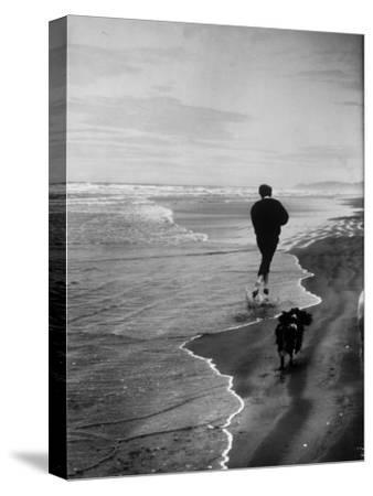 Robert F. Kennedy Running on the Beach with His Dog Freckles