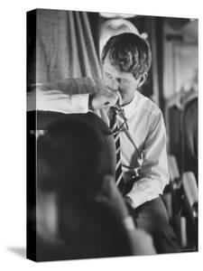 Senator Robert F. Kennedy Aboard Plane During Trip to Help Local Candidates by Bill Eppridge