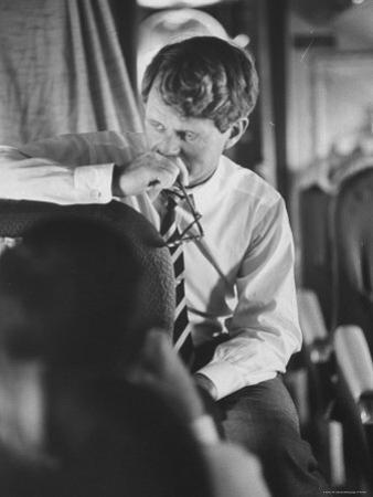 Senator Robert F. Kennedy Aboard Plane During Trip to Help Local Candidates by Bill Eppridge