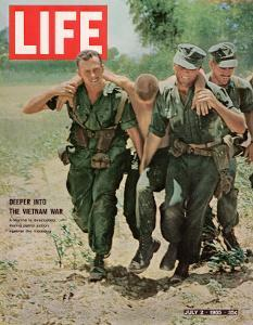 Wounded US Marine Helped to Safety by his Buddies During Fight with Viet Cong, July 2, 1965 by Bill Eppridge