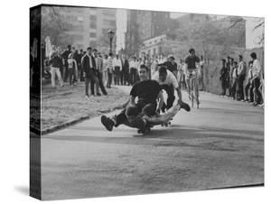 Youths Riding Skateboard by Bill Eppridge