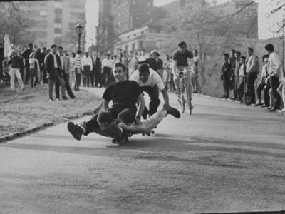 Youths Riding Skateboard by Bill Eppridge