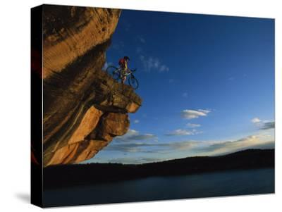 A Cyclist Atop a Rock Overhang Near Dolores, Colorado