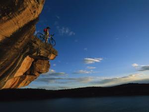 A Cyclist Atop a Rock Overhang Near Dolores, Colorado by Bill Hatcher