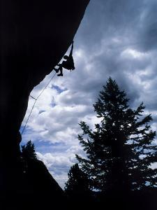A Rock Climber Ascends a Steep Route at the Wild Iris, Wyoming by Bill Hatcher