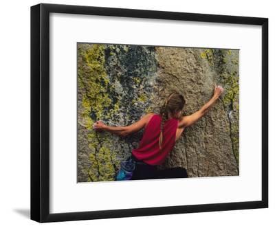 A Rock Climber on a Boulder