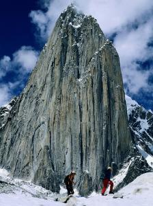 Expedition Members Hike Along Trango Glacier by Bill Hatcher