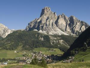 Italian Village Rimmed by Mountains in the Dolomites, Italy by Bill Hatcher