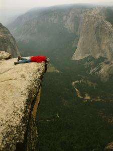 Prone Man Peers over Taft Point into the Yosemite Valley by Bill Hatcher