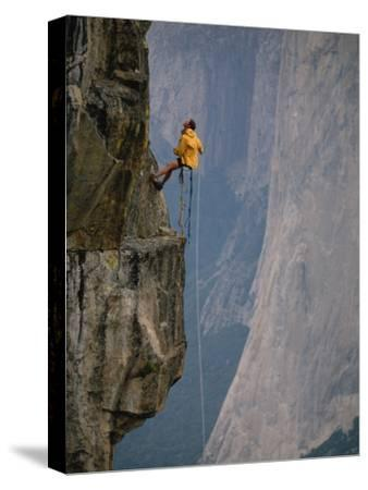 Rapeling Down a Cliff with El Capitan in Background, Yosemite National Park, California