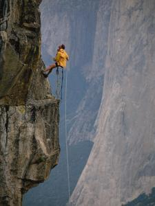 Rapeling Down a Cliff with El Capitan in Background, Yosemite National Park, California by Bill Hatcher