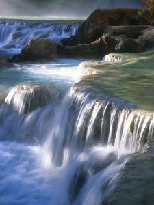 Water Flowes over Travertine Formations Below Havasu Falls by Bill Hatcher