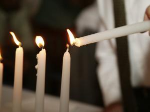 Boy Lighting Candles at Bar Mitzvah by Bill Keefrey