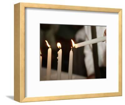 Boy Lighting Candles at Bar Mitzvah
