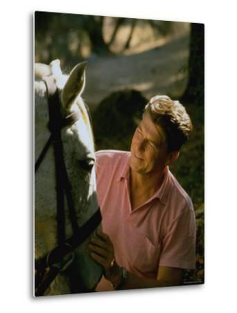Actor and California Gubernatorial Candidate Ronald Reagan Petting Horse Outside on Ranch at Home
