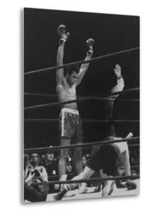 Boxer Muhammad Ali Raising His Gloves Victoriously After Knocking Out Oscar Bonavena by Bill Ray