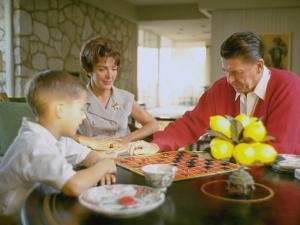 CA Gov. Candidate Ronald Reagan, Wife Nancy and Son Sitting at Table Playing Checkers at Home by Bill Ray