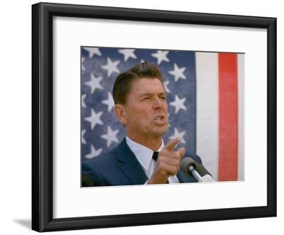 California Gubernatorial Candidate Ronald Reagan Speaking in Front of American Flag Backdrop