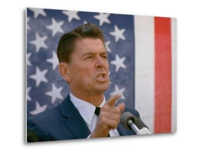 California Gubernatorial Candidate Ronald Reagan Speaking in Front of American Flag Backdrop