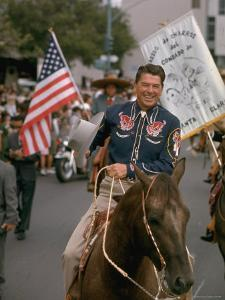 California Republican Gubernatorial Candidate Ronald Reagan, in Cowboy Attire, Riding Horse Outside by Bill Ray