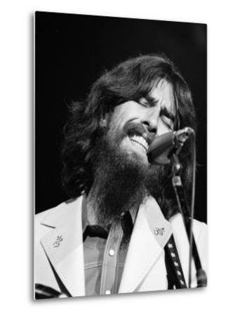 George Harrison Performing at a Rock Concert Benefiting Bangladesh, aka Kampuchea