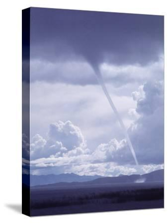 Large White Fluffy Clouds and Funnel Cloud During Tornado in Andean Highlands, Bolivia