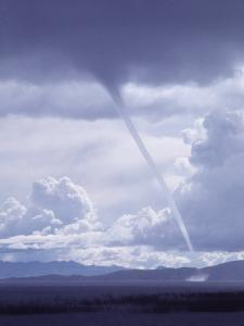 Large White Fluffy Clouds and Funnel Cloud During Tornado in Andean Highlands, Bolivia by Bill Ray