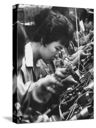 Matsushita Electronics Corp. Women Employees Working in a Factory