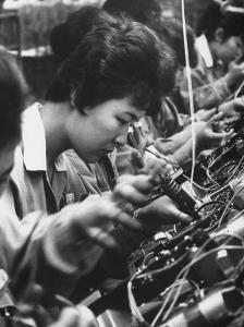 Matsushita Electronics Corp. Women Employees Working in a Factory by Bill Ray