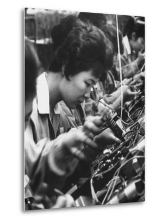 Matsushita Electronics Corp. Women Employees Working in a Factory
