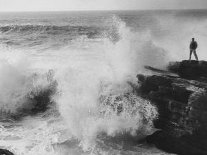 Oceanographer Willard Bascom Standing on a Rock while Observing the Crashing Surf by Bill Ray