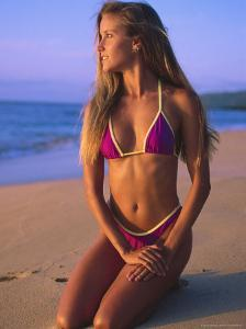 North Oahu, HI, Woman in Swimsuit Posed on Beach by Bill Romerhaus