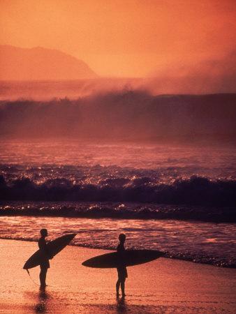 Surfers at Sunset, Oahu, Hawaii
