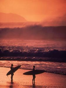 Surfers at Sunset, Oahu, Hawaii by Bill Romerhaus