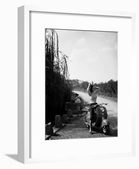 Billboard Advertising the Lambretta Innocenti Scooter-A. Villani-Framed Photographic Print